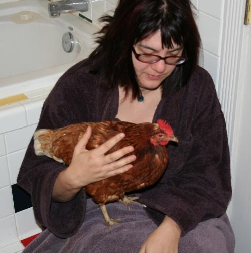 Betsy holding sick shy chicken